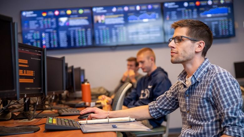 Students work at Bloomberg Terminals in Penn State Behrend's finance lab.