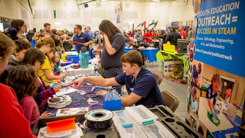 Children and parents look at exhibits at Penn State Behrend's sixth-annual STEAM fair