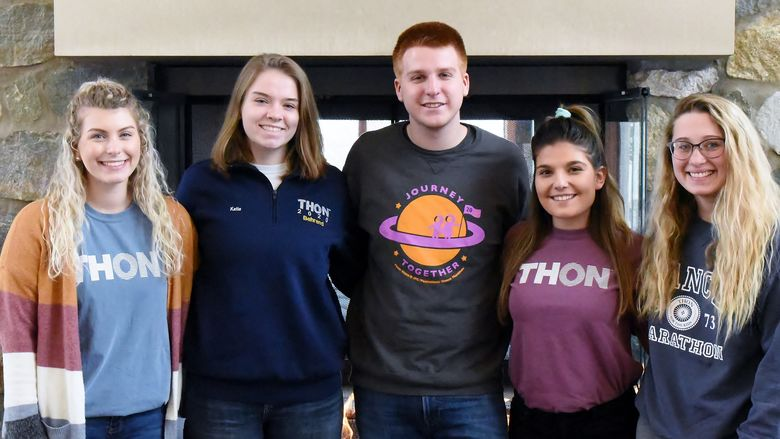 Five Penn State Behrend students pose for a group photo before THON.