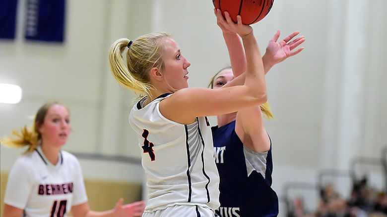 A Penn State Behrend basketball player shoots the ball.