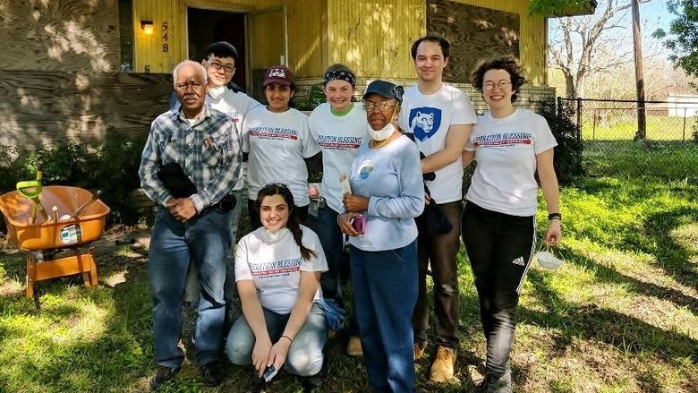 Penn State Behrend students pose with homeowners during a spring break service trip to Houston.