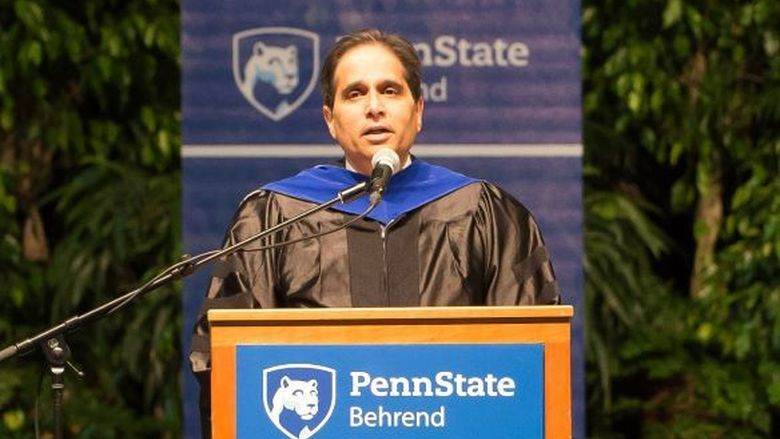Ashutosh Deshmukh speaks during a Penn State Behrend commencement program.