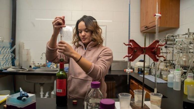 Penn State Behrend student Roni Stefanick works in the chemistry lab at Mazza Vineyards