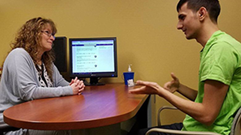 Career counselor speaks with student