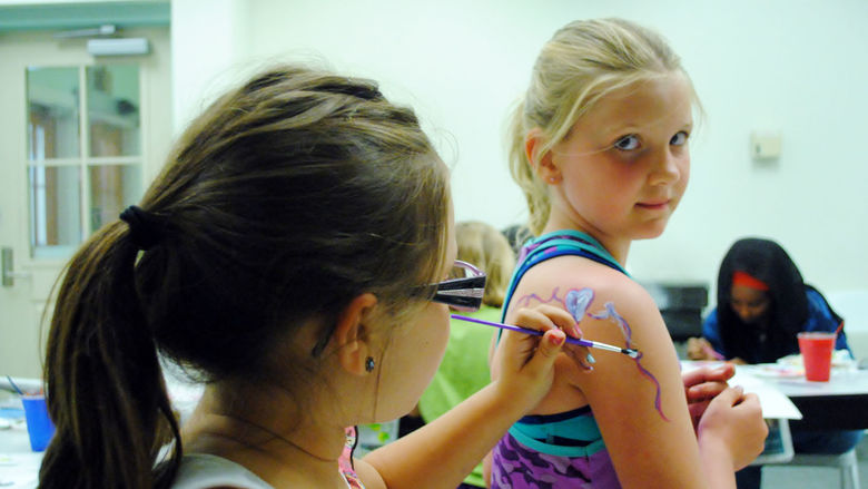 College for Kids students participate in a face painting class.