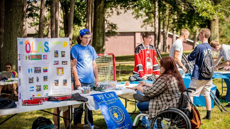 Club members meet with students at Penn State Behrend's annual outdoor Club Showcase.