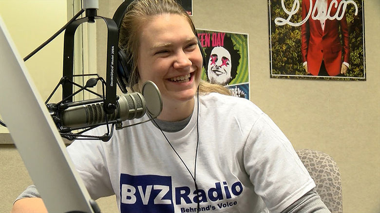A Penn State Behrend Communication student works at the student radio station.