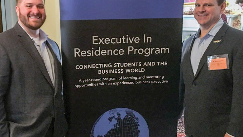 Executives in Residence Justin Bloyd '05, left, and Mark Nachman, hosted a networking event for Black School of Business students at the college's Logan House in March.