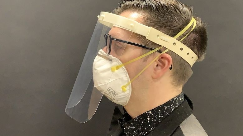 A product designer models the White Label Face Shield