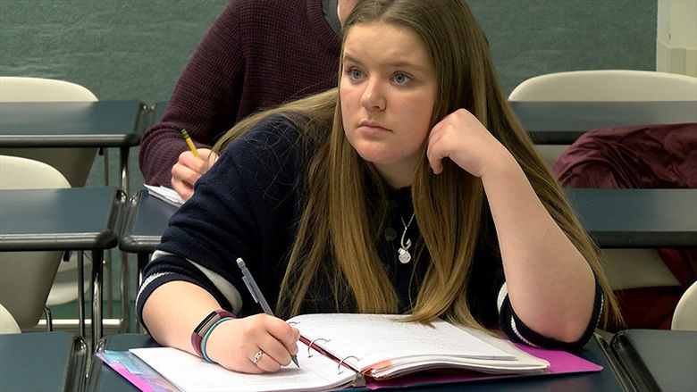 A Penn State Behrend History student attends a lecture.