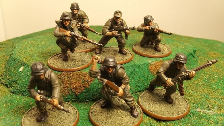 A close-up photo of a band of miniature soldiers.