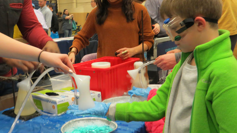 A student attends the GE STEM Fair.