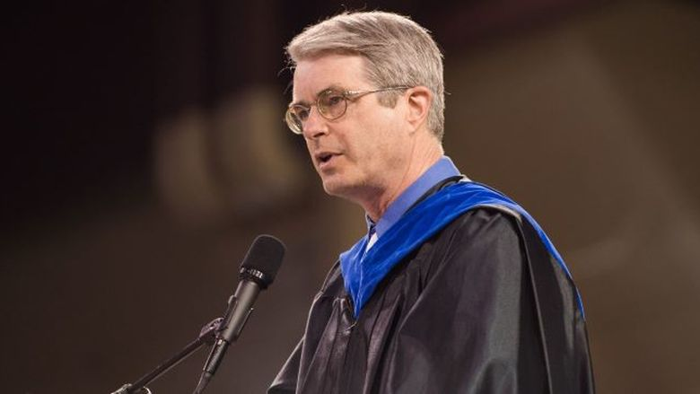 Penn State Behrend professor Jonathan Hall talks during a commencement program.