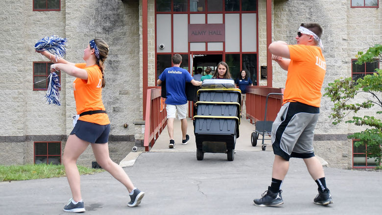 Two students dance during move-in day at Penn State Behrend