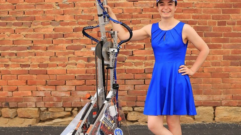 Penn State Behrend senior Julia Cecchetti stands next to a robotics project.