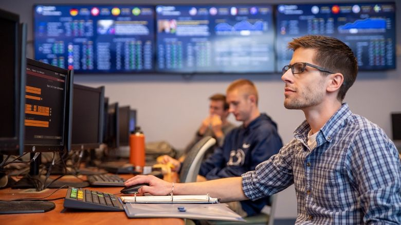 A student works at a computer terminal in Penn State Behrend's finance lab.