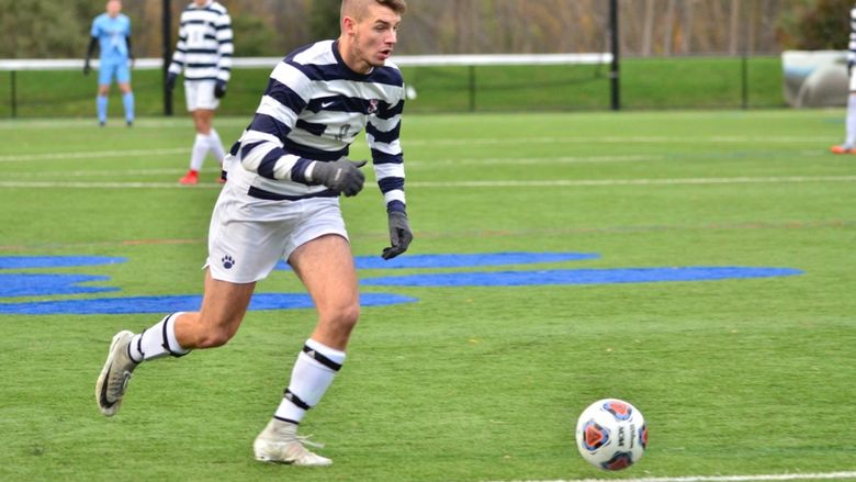 Penn State Behrend soccer player Richard Blanchard prepares to kick the ball