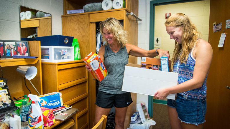A student and her mother unpack in a Penn State Behrend residence hall.