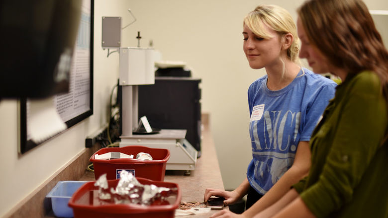 """Students participate in the """"Whatever Floats Your Boat"""" activity at Women in Engineering Day."""
