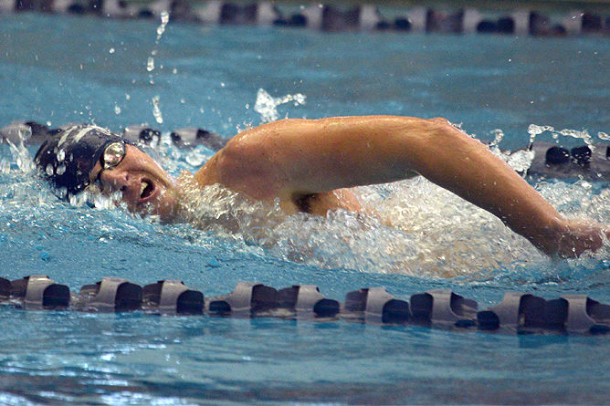 A Penn State Behrend swimmer competes in a freestyle race.