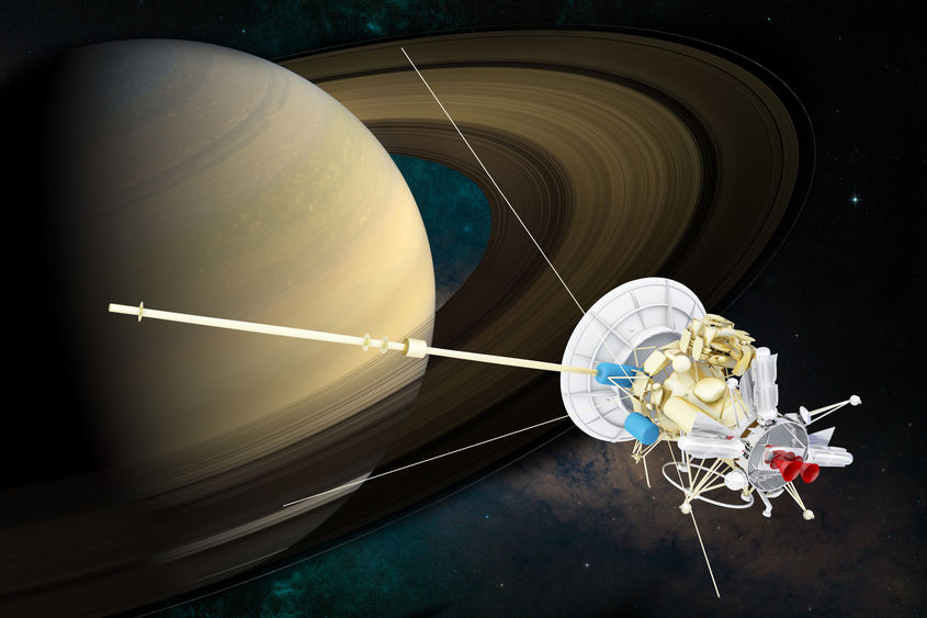 Cassini-Huygens spacecraft pictured next to Saturn.