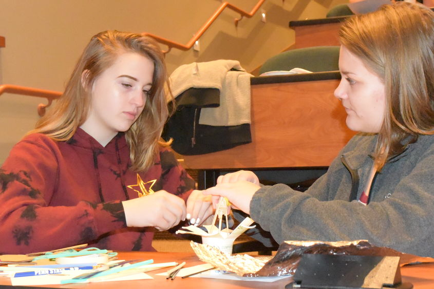 Ani Entrekin, left, and Maygan Stoddard work to create a dome during the Inspiring Bright Futures program, held May 22 at Penn State Behrend.