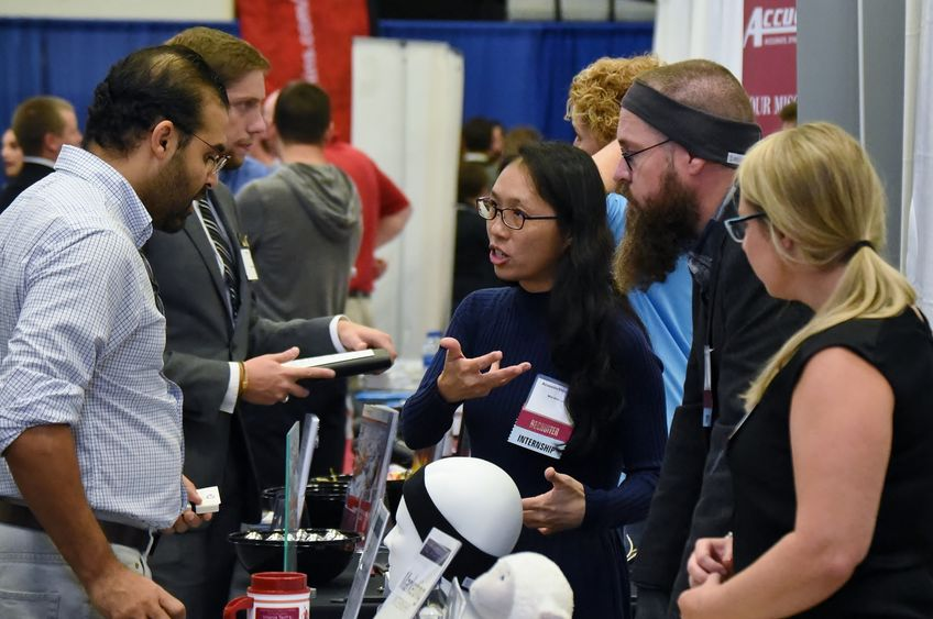 AcousticSheep LLC CEO Wei-Shin Lai, center, meets with a student during Penn State Behrend's Fall Career and Internship Fair, held Sept. 19 at the college.
