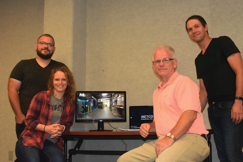 David Perkins, far left, Jodi Herman, and Jaimen Gallo, far right, are three members of Penn State Behrend's Centers for Teaching and eLearning Initiatives, who recently developed a 360-degree virtual tour of Metco Industries.