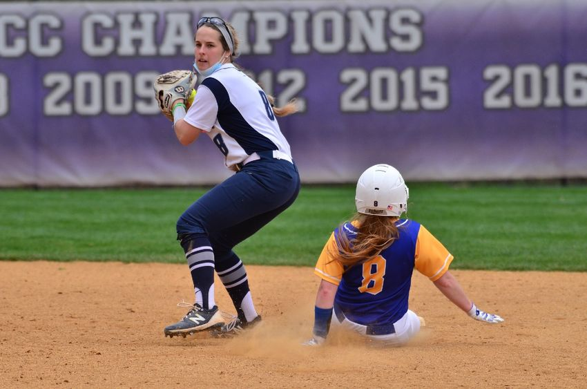 An infielder for the Penn State Behrend softball team prepares to throw the ball after a runner is tagged out..