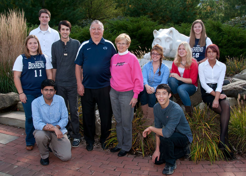 Joe and Isabel Prischak pose with scholarship recipients at the Lion Shrine at Penn State Behrend.