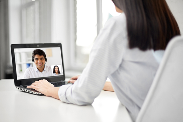 Female on computer talking to male on screen