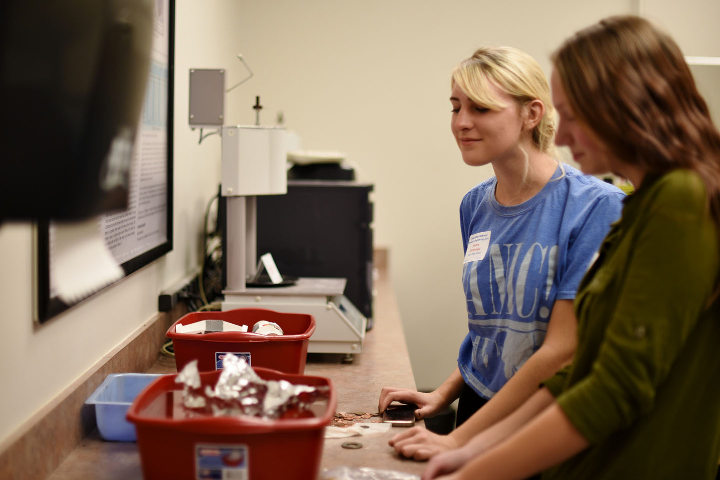 Two Women in Engineering students participate in an educational activity